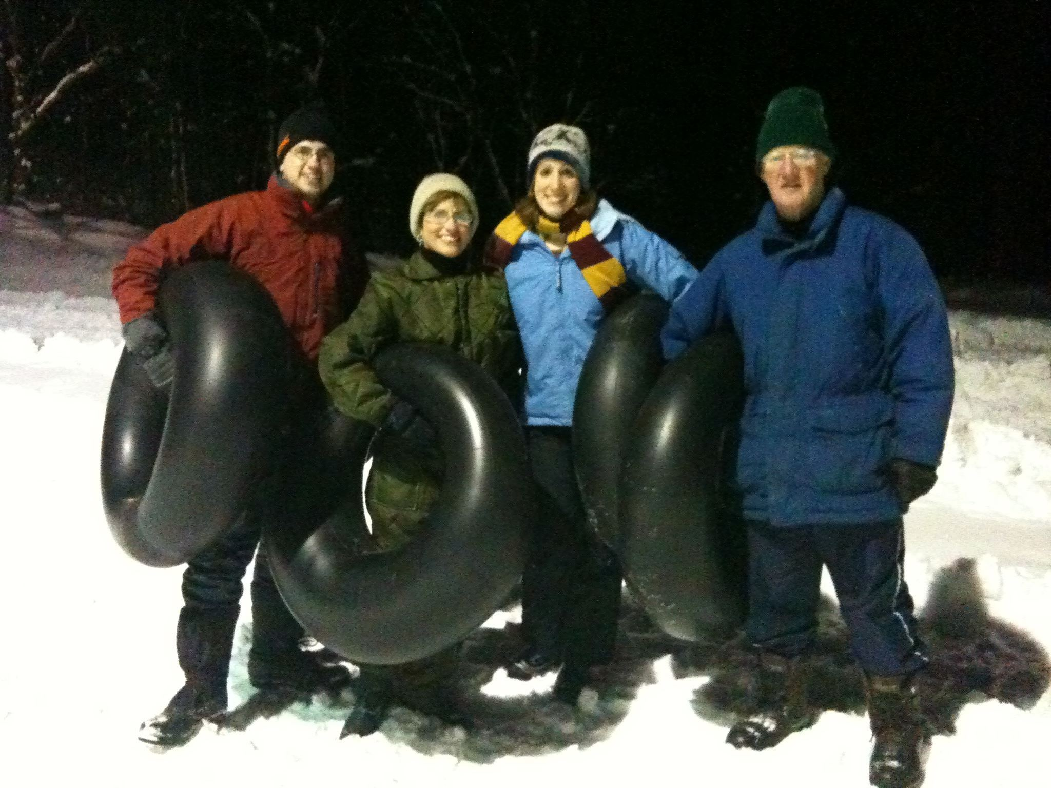 night time inner tubers in the snow