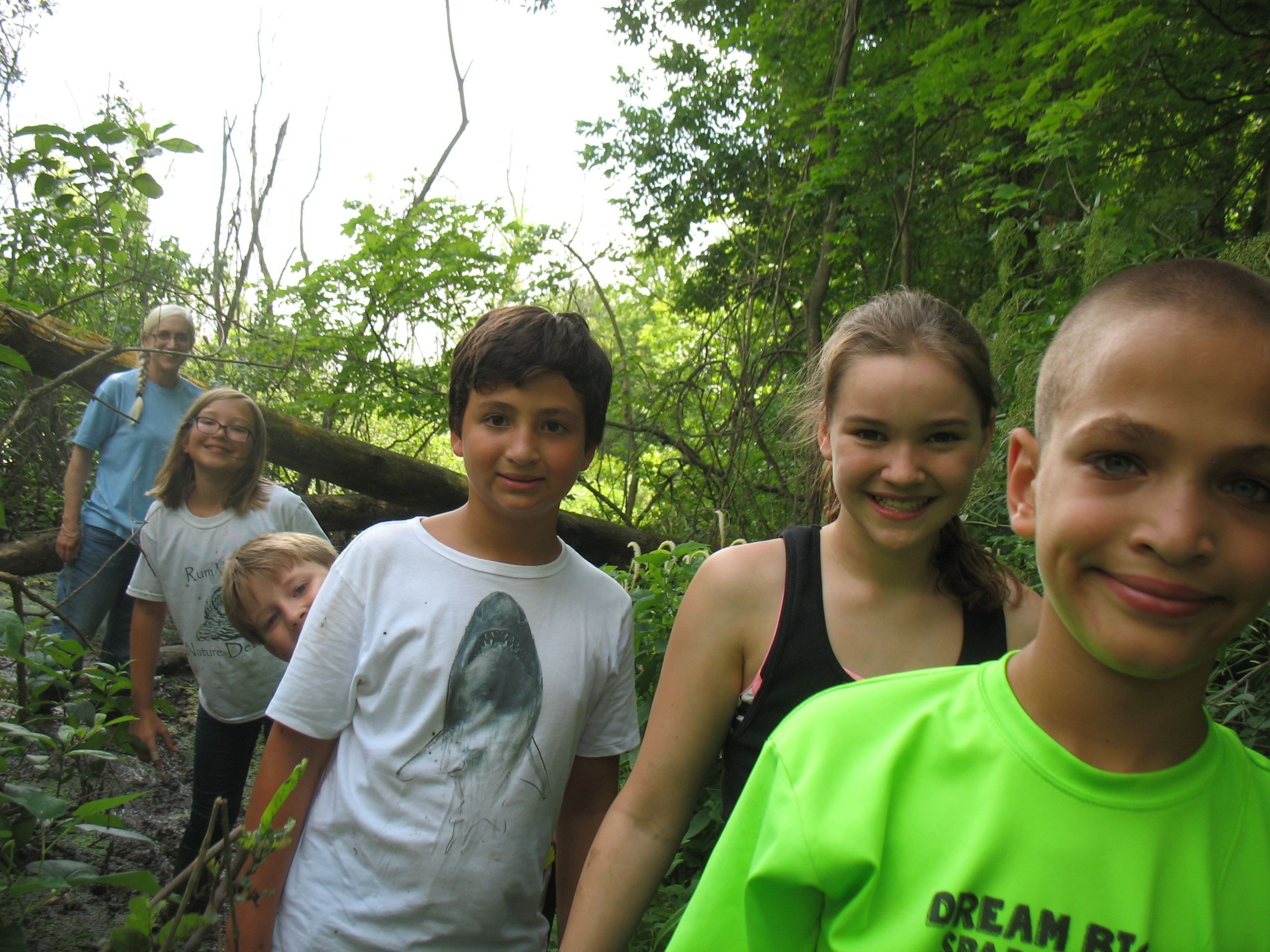 kids explore a swamp during Outdoor Adventures Day Camp