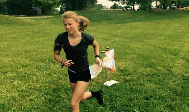 woman runs orienteering course