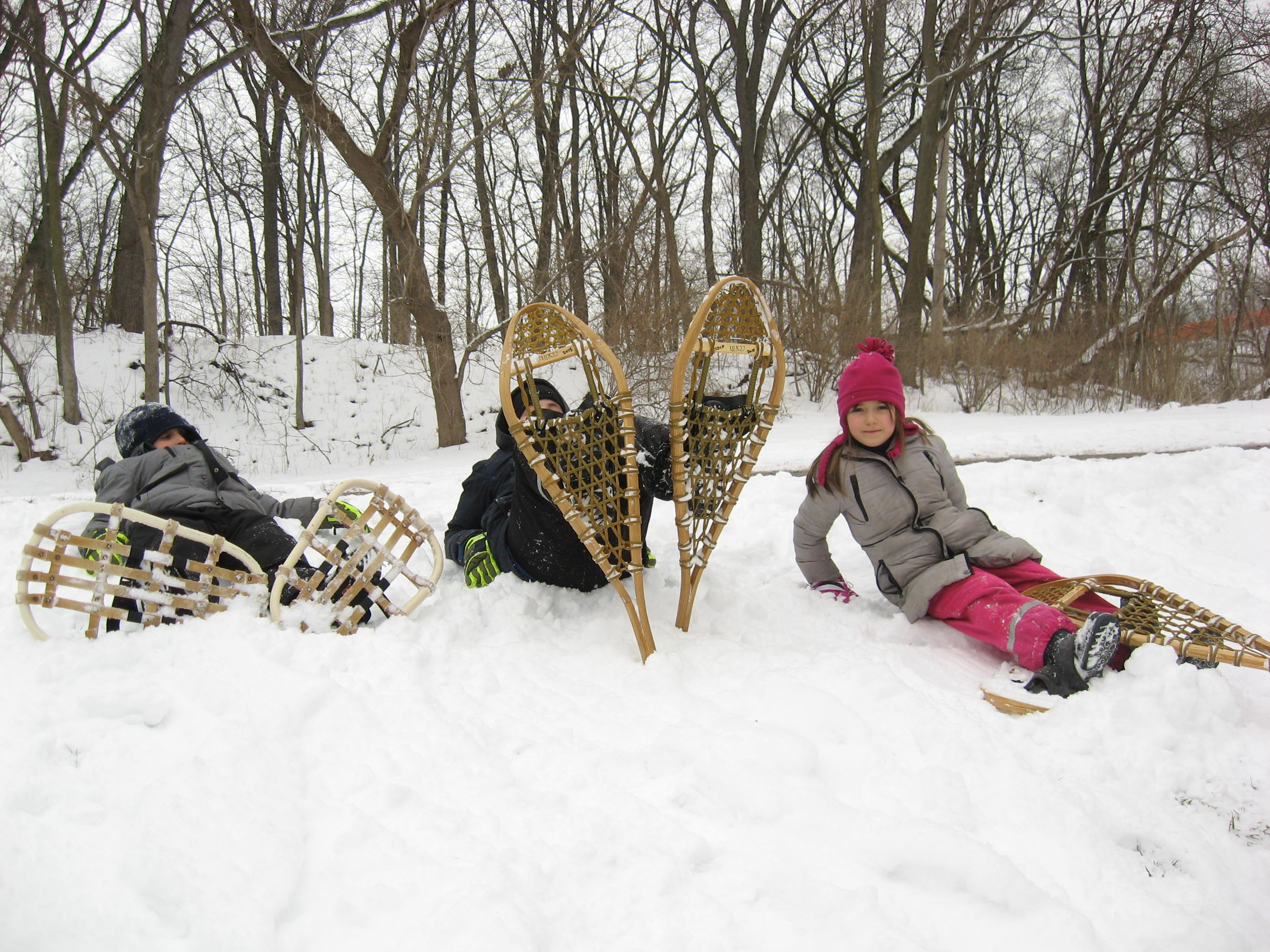 Snowshoers sit in snow