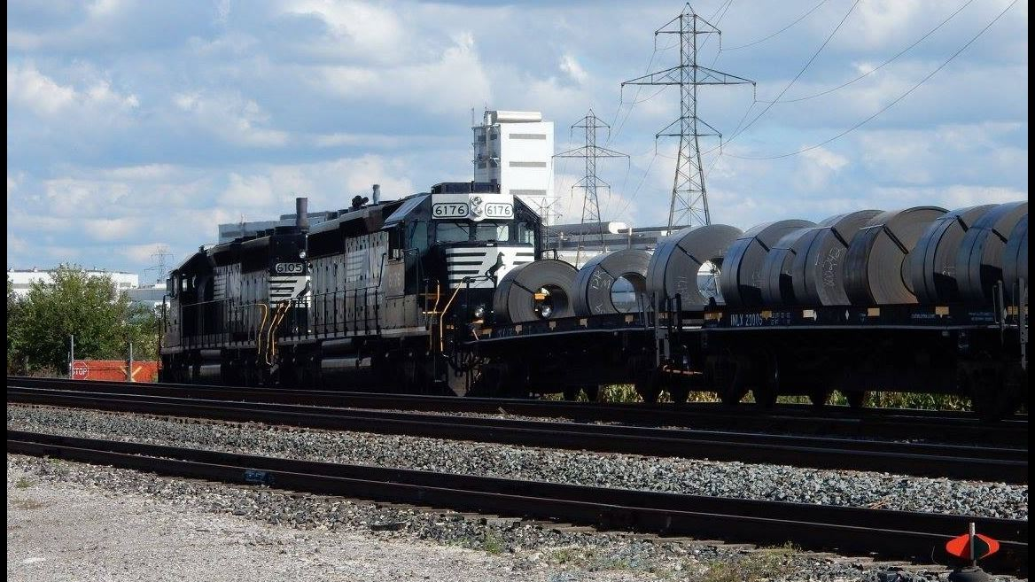 This is an image of a locomotive pulling steel coils to the I/N Tek processing facility